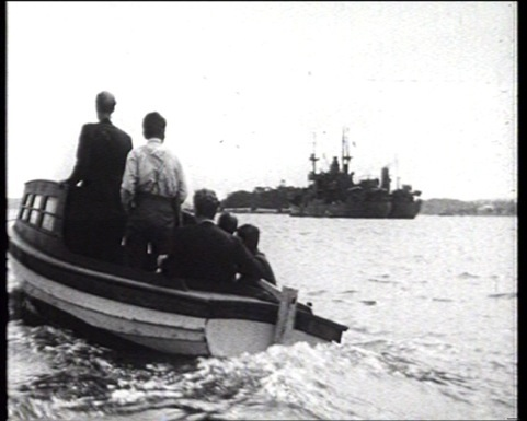 Indian seafarers and other activists, 1945, reenact their small boat pursuit of Dutch ship to call on crews to mutiny. Scene from Indonesia Calling, courtesy Heritage Films.